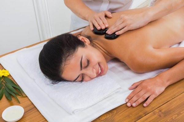 Client being massaged with stones