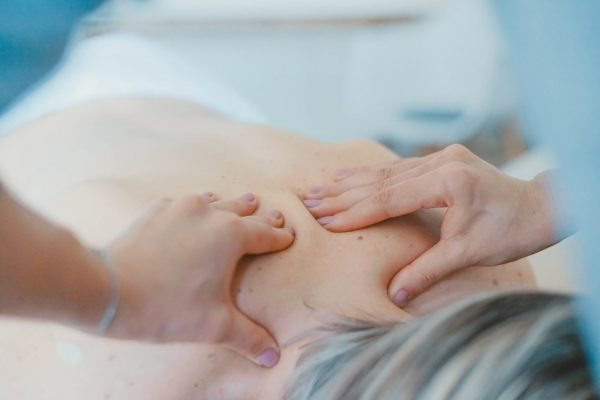 massaging upper back